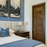 TM9000 pocket door in walnut with asymmetric stiles and kerf cut reveal