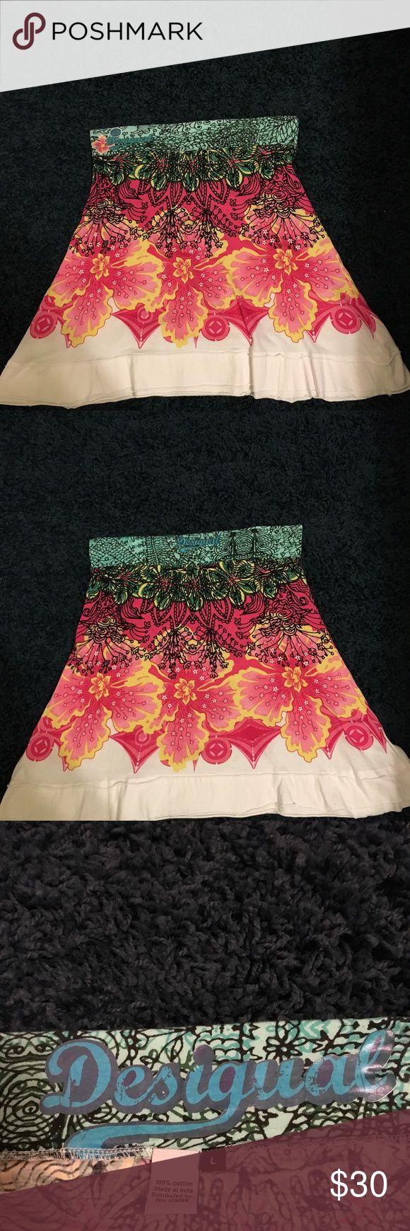 Desigual Skirt Beautiful Desigual cotton A-line skirt.  Multi colored with hot pink as the eye catching color on a white background.  It has a flat wide elastic waistband. Worn a few times and in very good condition.Fun and comfortable.  Great spring piece. Desigual Skirts Mini