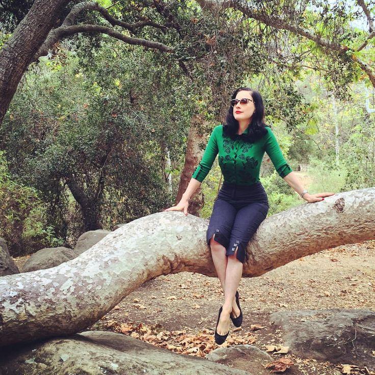 "Dita Von Teese on Instagram: ""Glamping in my @wheelsanddollbaby emerald green cardigan http://teese.us/cardigan"""