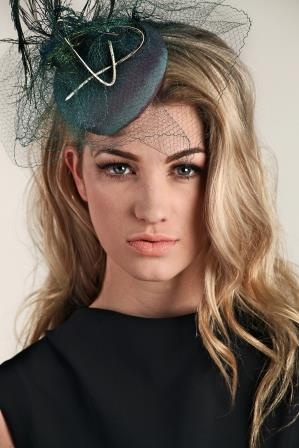 Noar Hill.  Button fascinator covered in vintage shot taffeta and trimmed with vintage veil and peacock swords.