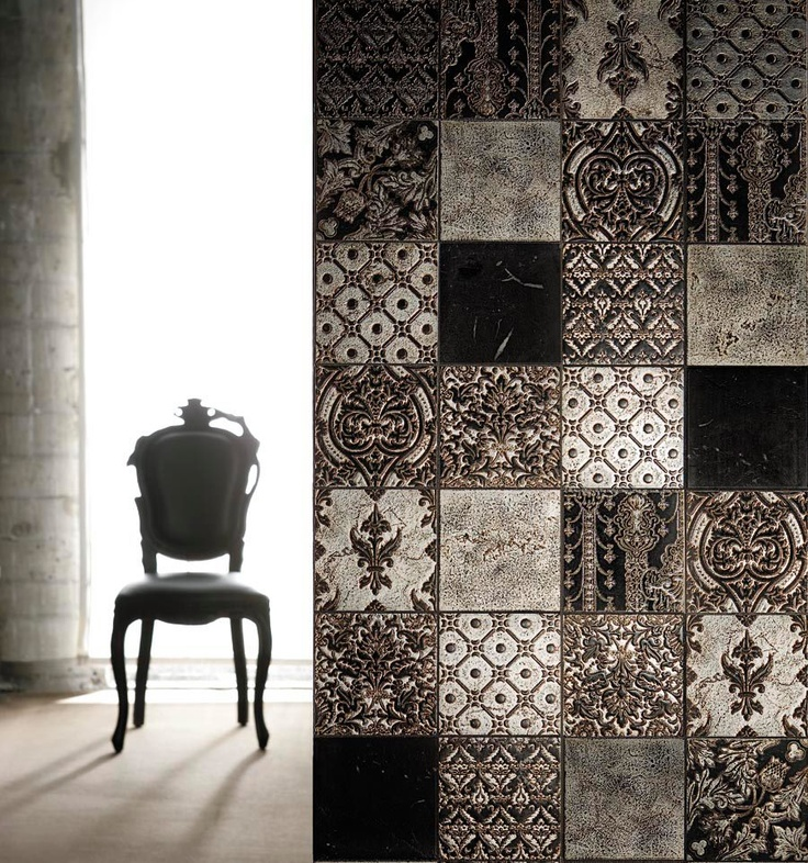 Lovely tile wall. Could be done with stencils and embossing with plasters http://www.petraantiqua.com/fra/collection2/emotions2.htm