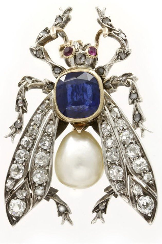A VICTORIAN SAPPHIRE, PEARL AND DIAMOND FLY BROOCH A Victorian sapphire, pearl and diamond fly brooch, the body of a sapphire, weighing 2.35cts in a gold rubover setting, and pear-shaped natural pearl, the wings set with old brilliant-cut diamonds and the legs with rose-cut diamonds, estimated total weight 0.50cts, silver set and mounted on gold, the eyes set with ruby, circa 1870.
