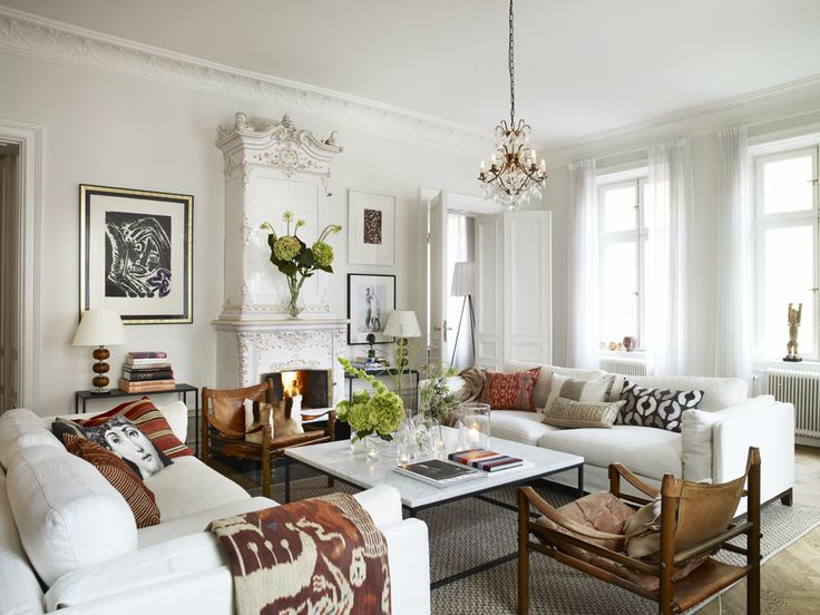 In the living room sofa, table, sidbord and carpets from Walles & Walles. Vintage armchairs are Arne Norells Sirocco.