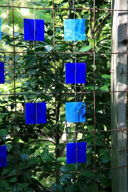 Stained glass & wire screen. Would work on almost any wire fence.