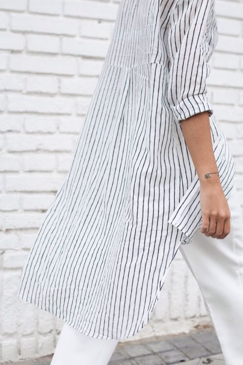 Striped lightweight cotton shirt! Not this long, but generally the same look.