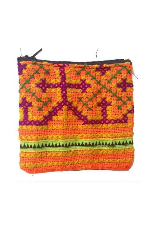 An adorable little vintage cross stitch coin purse hand woven in Northern Thailand. #offbeatcuts