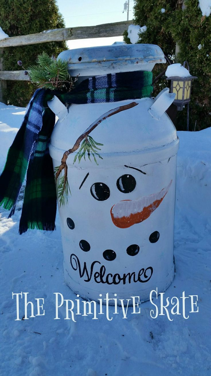 Snowman old milk can