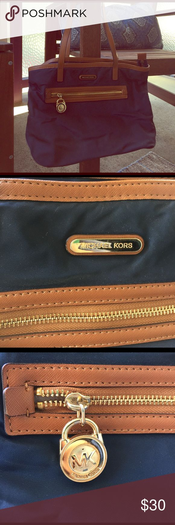 Michael Kors navy purse Michael Kors Navy purse. Marks as shown - otherwise great condition! Michael Kors Bags Shoulder Bags
