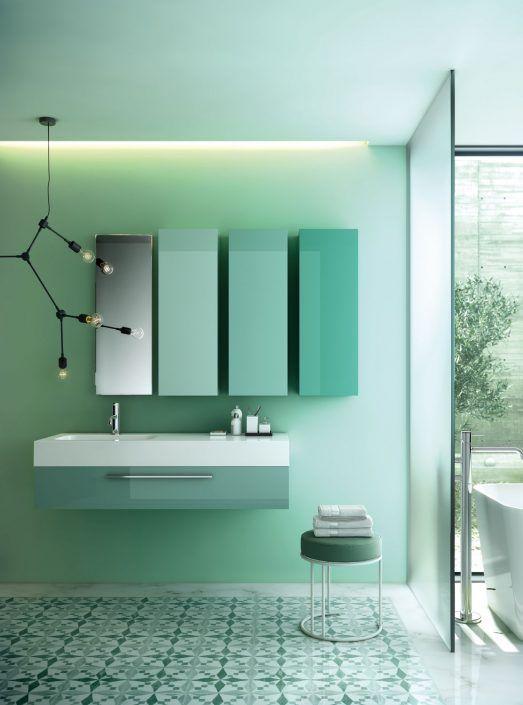 Muebles de baño personalizados, hechos a medida.  PLANTEAMIENTO 1. Entorno con un color dominante. 2. Suelo hidráulico que no se va a cambiar. SOLUCIÓN 1. Gama de color personalizada. 2. Conjunto muy moderno que contrasta con el estilo vintage de la estancia.