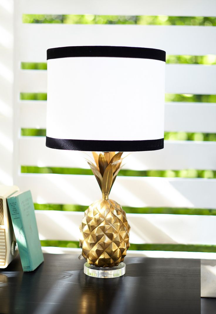 The Emily & Meritt Pineapple Table Lamp: Aloha! This pineapple-shaped lamp adds a warm and welcoming glow to your favorite space. Boasting a pretty, gilded finish, it's a gorgeously tropical accent to your bedside table, vanity or desk! Imagined exclusively for PBteen by celebrity stylists and fashion designers Emily Current and Meritt Elliott, it captures their classic and rebellious aesthetic.