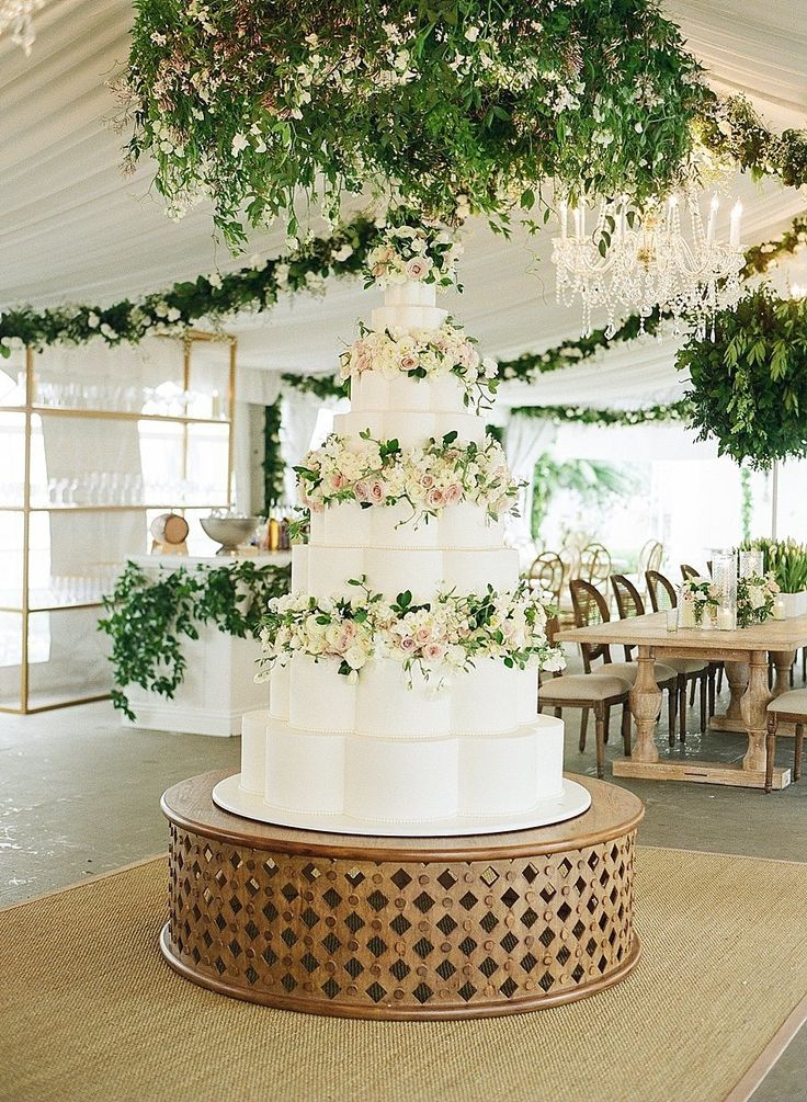 Swooning over this large wedding cake that stands out at the reception.