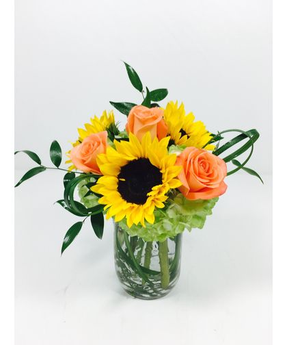 Sunshine Medley-Bright sunflowers and Orange roses with green hydrangea arranged in a mason jar and finished with lily grass. #ToblersFlowers #KansasCityFlowers #GetWellFlowers
