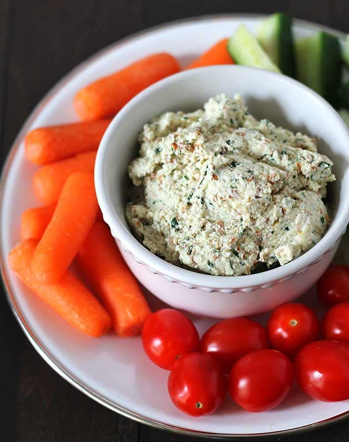 This garlic herb vegan almond cheese spread is bursting with flavour and can be used in many ways. It's great on crackers, sandwiches, and as a veggie dip!