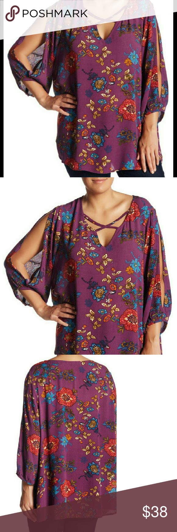 "Lucy Plus Size Floral Tunic Lucy is a lovely asian inspired floral tunic blouse. Has V-neck w/ criss cross details, 3/4 sleeves with cold shoulder cut outs and banded trim.  Split sides seams, curved hem, approx 30"" long. Model is wearing a 1X bust 36-waist 39-hips 39.  100% rayon  arrives 1/6/17 Tops Tunics"