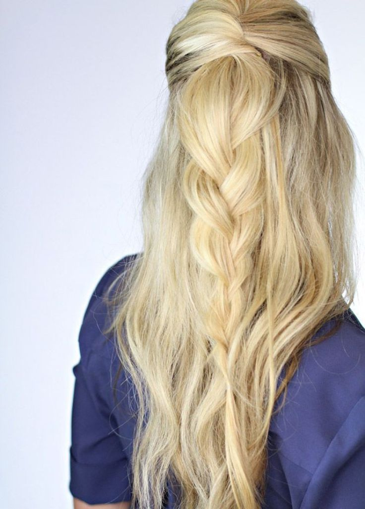 Loving this sweet and romantic look! She is rocking a half up braided look on wavy blonde hair!  You can get this cool look with day old curls!