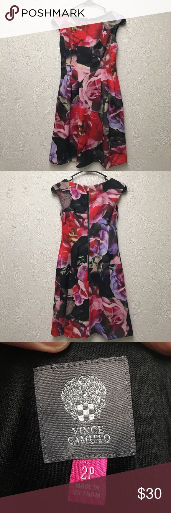 Vince Camuto   Dress Lovely Vince Camuto sleeveless dress in size 2 Petite. Zip back, lined, and has some pleating at hips. Pretty floral design, great colors of red, pink, black, and green and even some blues and purples! Perfect for dinner or a night out! Excellent condition and looks brand new. Vince Camuto Dresses