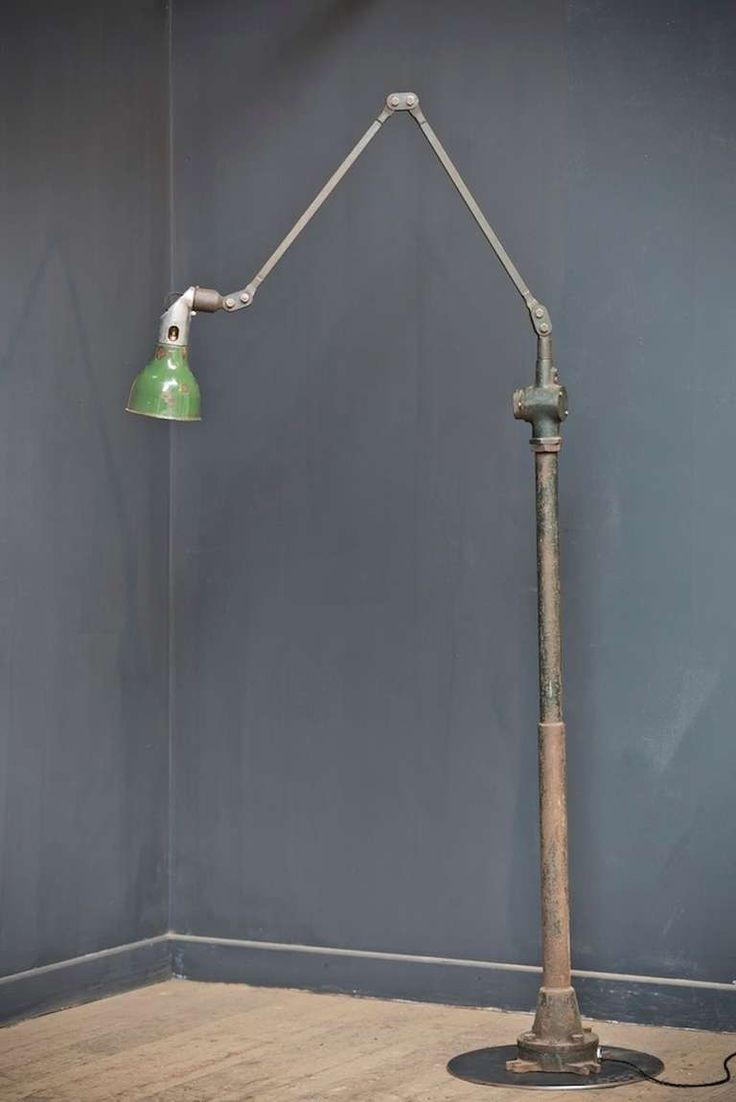 A single factory Mek-Elek floor standing lamp. In untouched original industrial condition, missile switch to side, adjustable arm, green enamel shade. Marked 'MEK-ELEK, LONDON' English, 1950s