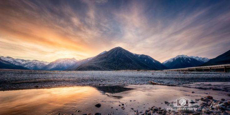 Art print of sunset and mountain reflection at Arthurs Pass, New Zealand