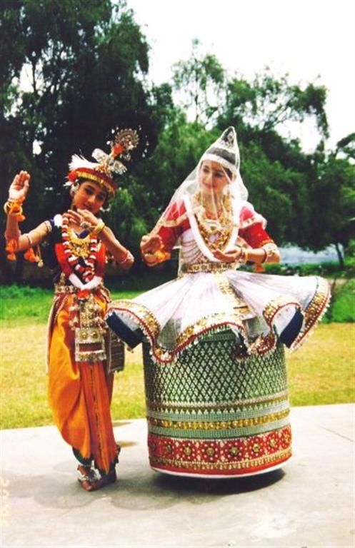 The love story of Radha and Krishna are commonly acted out in Manipuri dance drama performance.