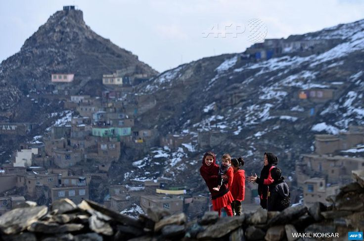 Afghan children play near their home on a hilltop overlooking Kabul. Photo by @kohsar