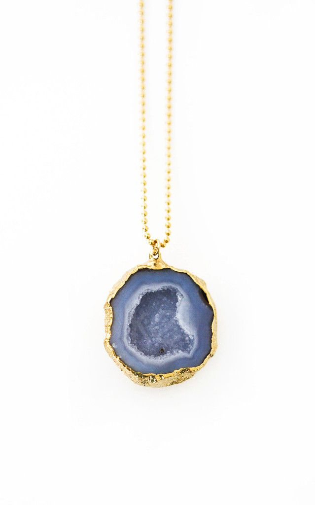 Open up a geode and magic happens as shiny little crystals emerge inside! This necklace is an absolute stunner. Made with a real agate geode cut in half with a sparkling druzy interior, each piece is