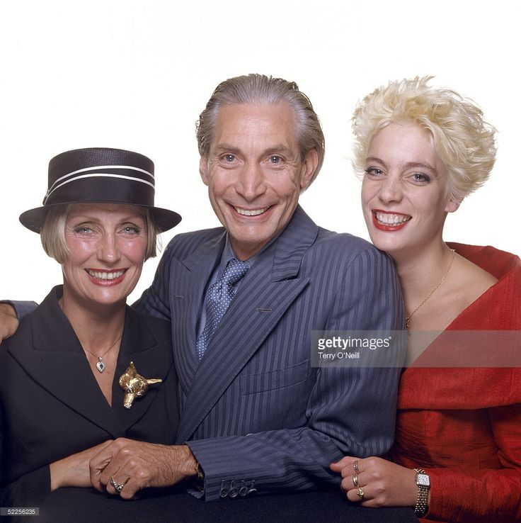 Rolling Stones drummer Charlie Watts posing with his wife Shirley and daughter Seraphina at Bill Wyman's wedding to Mandy Smith in London, 5th June 1989.