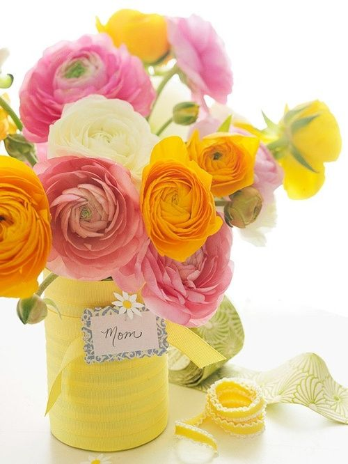 Fresh colorful flowers in mason jars wrapped with yellow fabric and ribbon.  Beautiful idea for spring!  <3<3<3