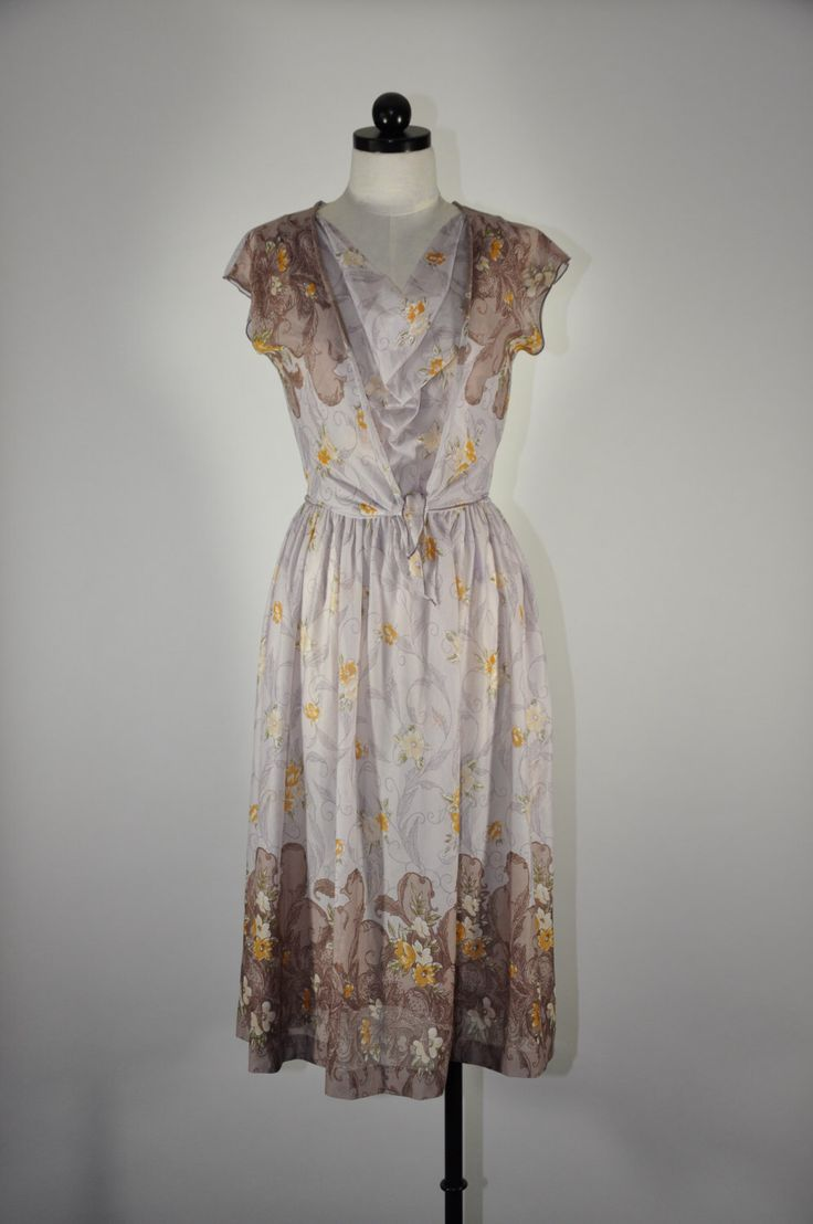 20% OFF 70s two piece sleeveless dress / vintage sheer chiffon floral dress / lavender dress and shrug set by QuietUnrest on Etsy https://www.etsy.com/listing/159543621/20-off-70s-two-piece-sleeveless-dress