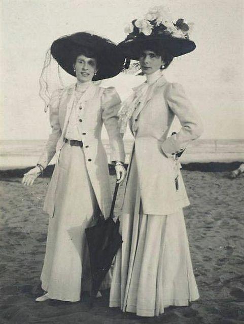 Two Women on Beach wearing large black hats 1900s by Adolph De Meyer