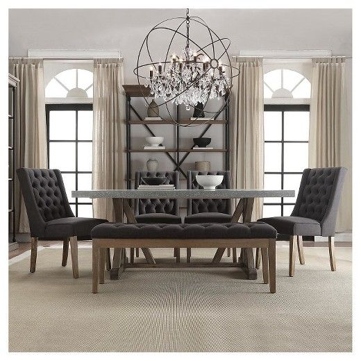 The Sullivan 6-Piece Hostess Dining Set is an opulent dining set that turns a meal into a banquet. Inspired by classical designs, this large dining table has a concrete table surface supported with a pedestal trestle base. But the real kicker is the seating: this set pairs 4 tufted dining chairs with a matching backless dining bench. The tufted high-back chairs swath guests in comfort, and subtle wingbacks make these seats extra cozy. The coordinating bench adds dynamic variation, and opens…
