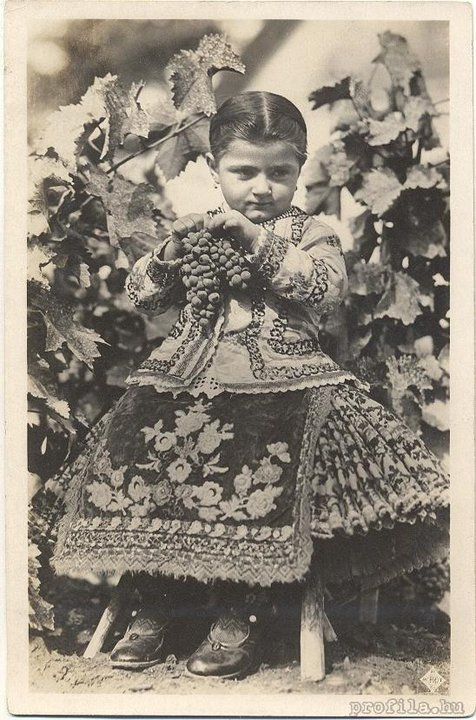 I have no idea as to when this photo was taken...but the folk costume is beautiful :)