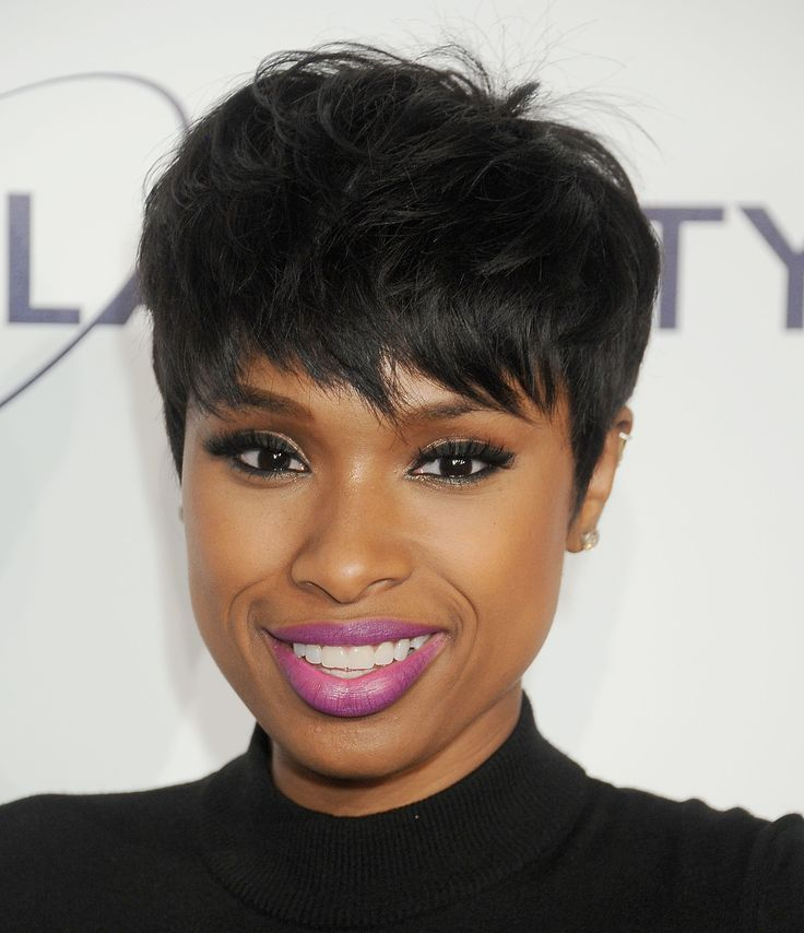 Jennifer Hudson stuns with purple lips, lush lashes, and just a hint of glitter.