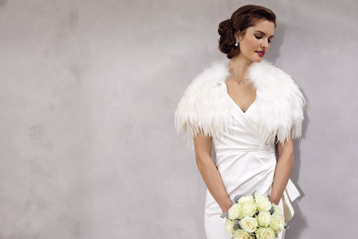 Feel elegant in our Debut satin bridal dress with shimmering stone embellishments and a timeless shawl neckline.