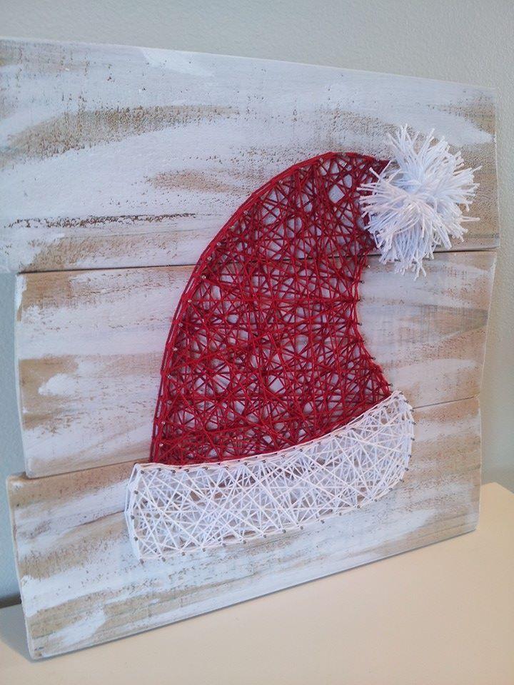 Santa hat string art. Check us out on Facebook at All Strung Up https://www.facebook.com/pages/All-Strung-Up/915873695199667?ref=hl
