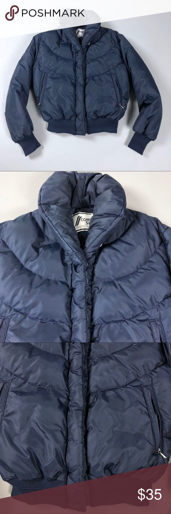 """Vintage 80s Puffer Down Jacket Vintage 80s Comfy Ski USA Womens Navy Blue Puffer Down Coat Jacket   Labeled size 10, but vintage sizing tends to run small & this fits more like a women's size Small.  100% nylon with down fill & 100% polyester lining.  As all brands are sized differently, please review measurements to ensure a proper fit.  Bust: 40"""" Length: 19.5"""" Sleeve: 24"""" from shoulder seam to end of sleeve  Very good condition. Small hole in one sleeve as pictured. Has pilling on the knit…"""