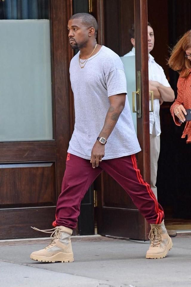 093cc178 Kanye West wearing his Calabasas pants by Adidas and Yeezy military boots