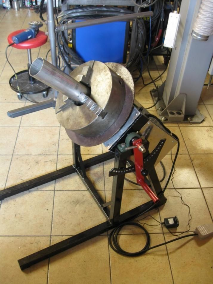 Welding Positioner by radom -- Homemade welding positioner comprised of a surplus lathe chuck mounted on a thrust bearing. Powered by a 12V DC motor via PWM controller. http://www.homemadetools.net/homemade-welding-positioner-11