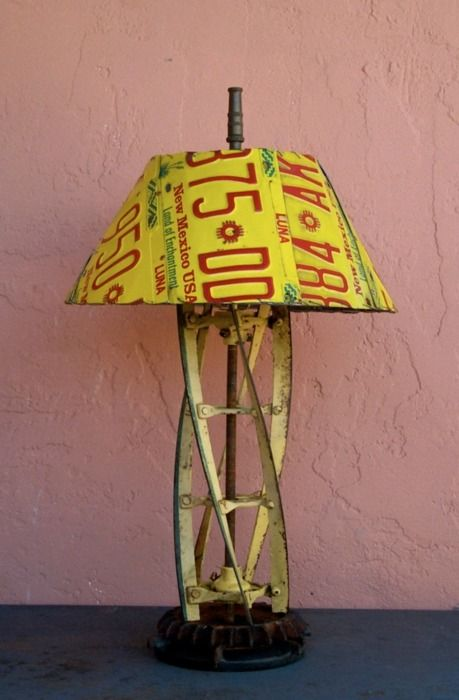 pretty cool: lamp made from upcycled license plates and an old rotary lawn mower blade.