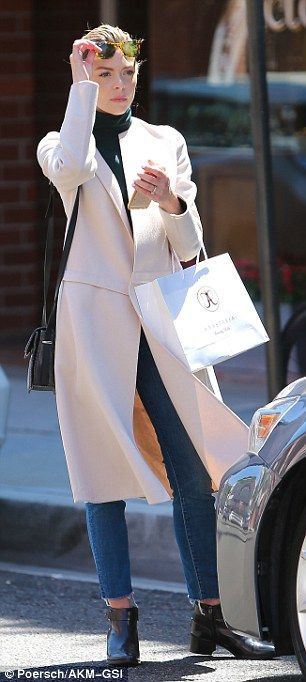 "The 5'9"" former model covered up with a mid-calf length stone coloured trench coat, after ..."