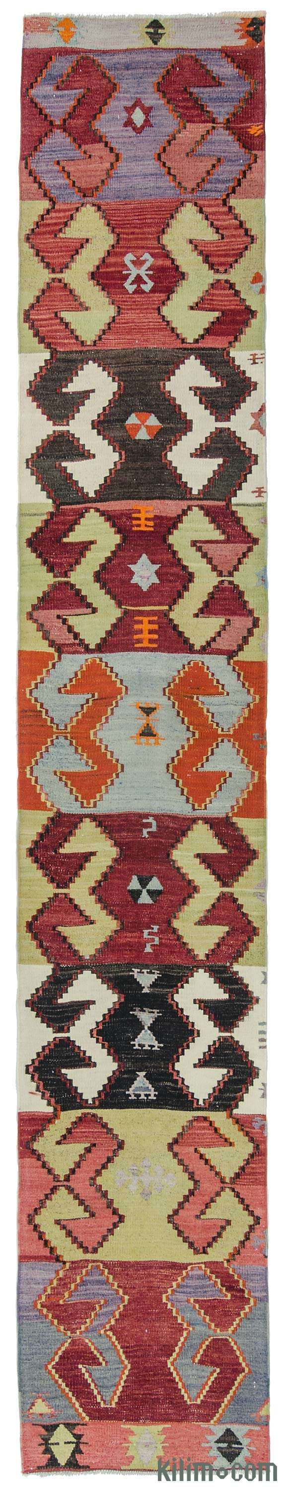 Vintage Turkish kilim runner rug hand-woven in the second half of the 20th century in Afyon located in the Aegean region of Turkey. This kilim is in very good condition.