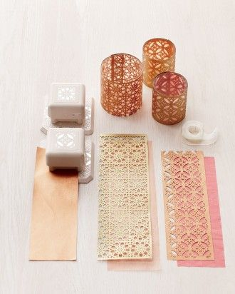 The intricate detailing in your favorite craft punch will really shine when it's wrapped around a humble glass votive holder. Gold paper may gleam, but plain brown kraft paper looks pretty, too.