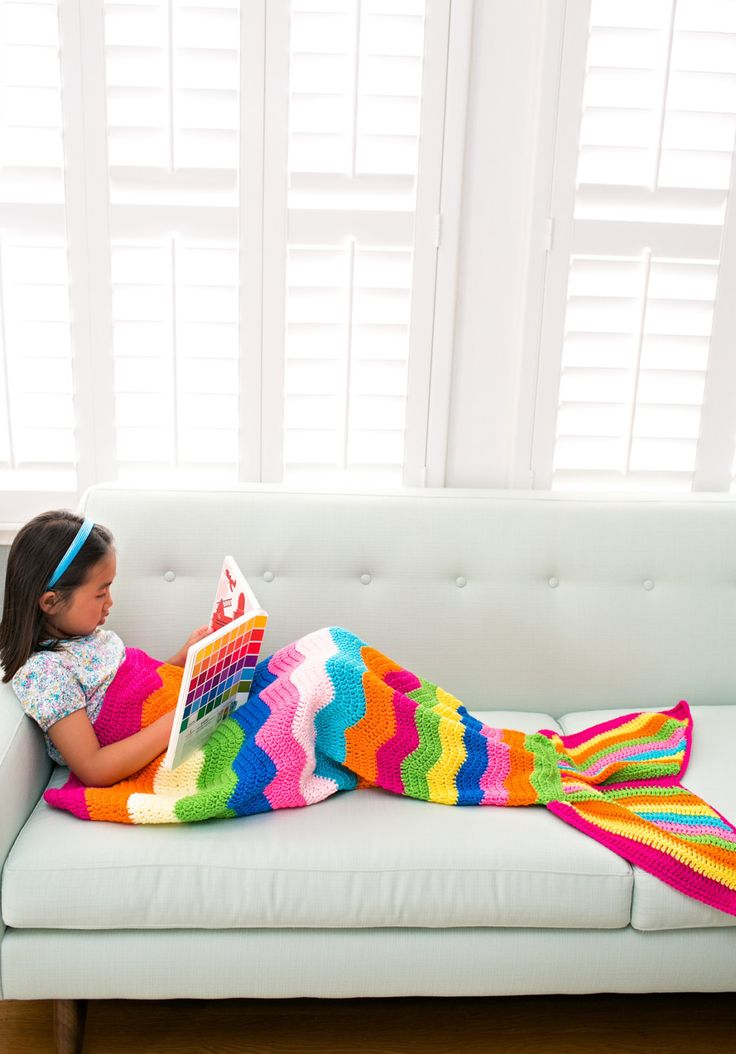 {MADE TO ORDER} This beautiful handmade crochet mermaid tail blanket is perfect for kids to cozy up to a book. Warm, snuggly and totally fun for pretend play! Made of 100% soft, high quality acrylic yarn.  The tail measures approximately 21 inches across the top, 39 inches long to the bottom (not including fin) and 49 inches from top to fin. This one is made to order as shown in gorgeous rainbow colors. Fits child recommended age 3-7 years. Care: machine wash delicate cycle, dry with low…