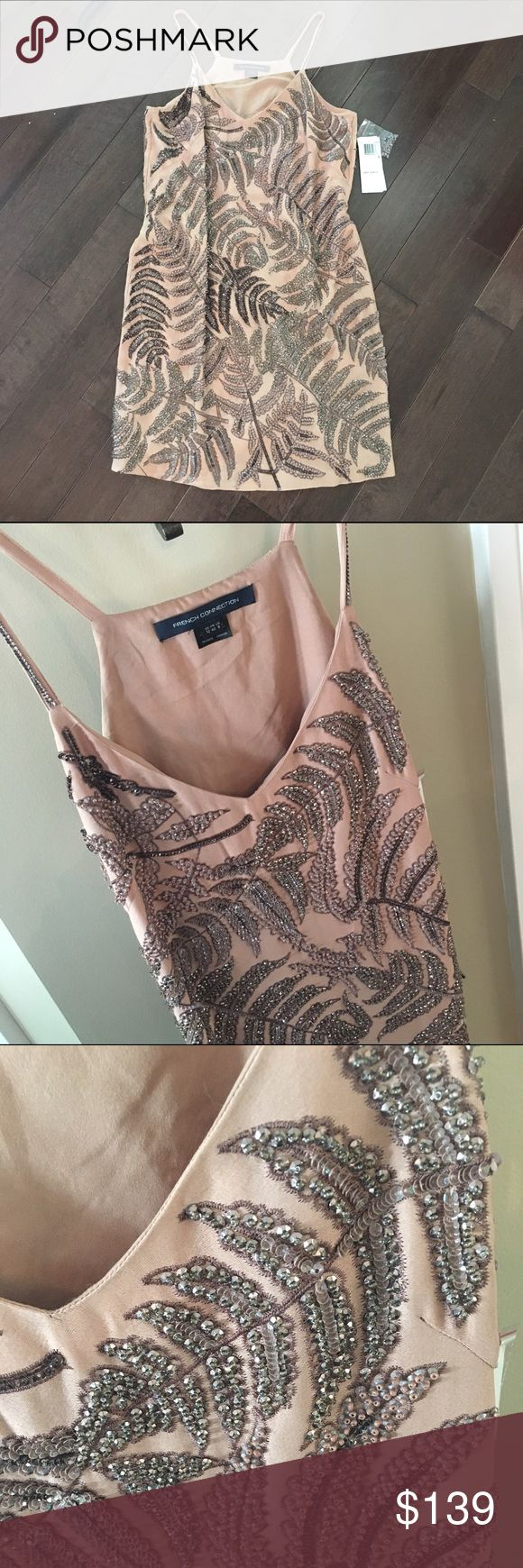 FRENCH CONNECTION Nude Sequin Dress Sz. 8 NWT I contemplated many times whether not I should list this beautiful dress, but, ultimately, I decided to list it, as I don't think I will ever wear it. Still has tags attached, $398 in stores.  This dress is a head-turner for sure! It has been hanging in the closet, so I do not think any of the sequins are missing.  If you do you lose a sequin, or find that there is a sequin or two missing, there is a bag of sequins given from French Connection…