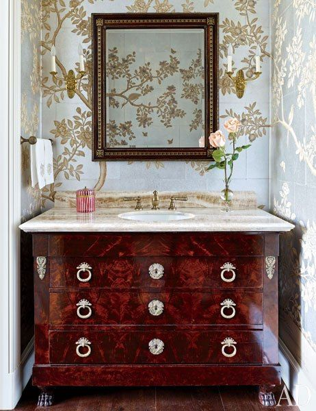 Gracie wallpaper lines a powder room at this art-collecting Houston couple's home. The vanity was made from a Directoire commode.