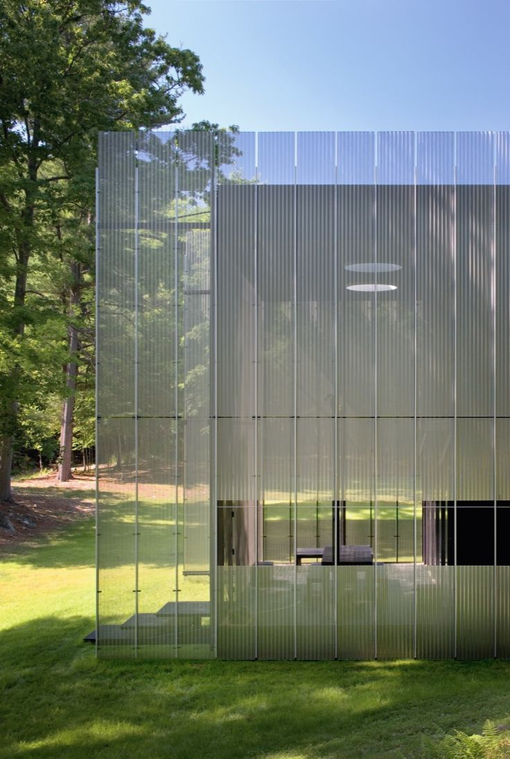 Thomas Phifer the Salt Point House New York, USA. In brilliant daylight, the house has an ethereal presence, its edges seemingly dissolving into the surrounding forested landscape