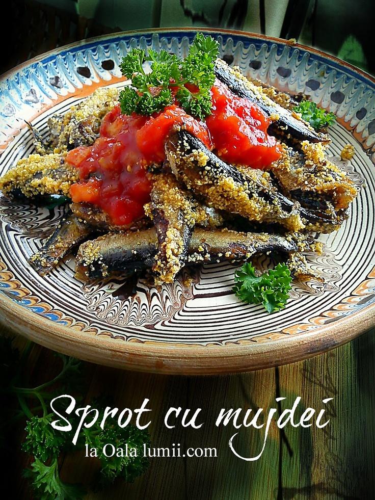 Sprot cu mujdei dobrogean    -Sprat with sauce(garlic, chili, salt, vinegar, oil, parsley,tomatoes)