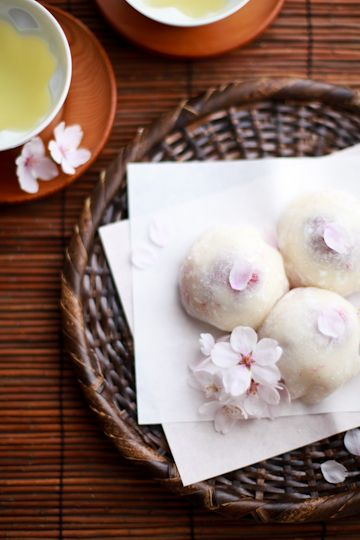 sakura-cream ichigo daifuku (strawberry mochi with whipped cream and cherry blossoms