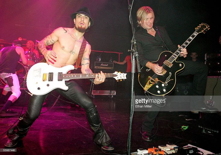 Camp Freddy guitarist Dave Navarro (L) and guitarist Billy Duffy from The Cult, perform at the grand opening of the Empire Ballroom October 22, 2005 in Las Vegas, Nevada.