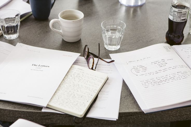 all the vital things: glasses, notebooks, caffeine, water