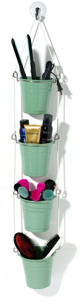 hanging ikea fintorp utensil storing a hair straightener, beauty products, makeup brushes, and hair brushes